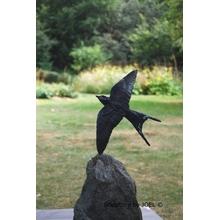 Blue flash of Swallow wings over green avanturine